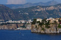 Greek isle with houses on cliff white and blue sea Stock Photography