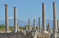 Greek remains the of perge turkey with columns and snow covered mountains in the background Royalty Free Stock Images