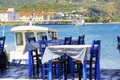 Greek restaurant a view of a typical at the town of gytheio in lakonia peloponnese greece the blue chairs and patterned table Royalty Free Stock Images