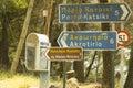 Greek road signs and telephone booth Стоковые Изображения