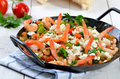 Greek saganaki food with shrimps vegetables and feta cheese Stock Photography