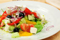 Greek salad classic on a dish in restaurant Royalty Free Stock Image