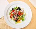 Greek salad classic on a dish in restaurant Royalty Free Stock Images