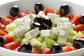 Greek salad feta cheese black olives cucumber tomatoes Stock Photos