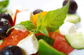 Greek salad with feta tomatoes and black olives selective focus Stock Photos