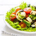 Greek salad fresh in a plate on the table Stock Photography