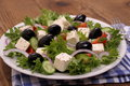 Greek salad with gigantic black olives sheeps cheese close up Stock Photos