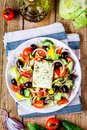 Greek salad of organic tomatoes, cucumber, red onion, olives and feta cheese Royalty Free Stock Photo