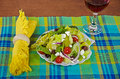 Greek salad with red wine fresh on a plaid place mat Royalty Free Stock Image