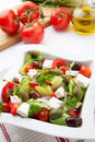 Greek salad refreshing crispy with cherry tomatoes olives bell pepper caperberries and feta cheese Stock Photography