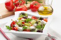 Greek salad refreshing crispy with cherry tomatoes olives bell pepper caperberries and feta cheese Stock Photos