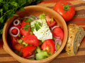 Greek salad on a striped tablecloth Royalty Free Stock Image