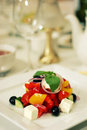 Greek salad with tomato olives on plate Royalty Free Stock Photo