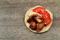 Greek souvlaki with pita bread and vegetables close-up on the table. Pork table Royalty Free Stock Photo
