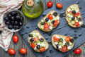 Greek style crostini with feta cheese, tomatoes, cucumber, olives and herbs Royalty Free Stock Photo