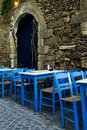 Greek tables and chairs. Royalty Free Stock Images