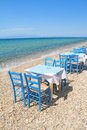 Greek tavern by the sea typical cafe aegean Royalty Free Stock Image