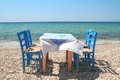 Greek tavern by the sea typical cafe aegean Royalty Free Stock Photo