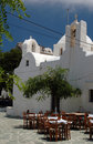 Greek taverna and church and monastery Stock Photo