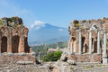 Greek theater Taormina city with a panorama at the Etna, Sicily Royalty Free Stock Photo