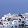 Greek town by blue sea aerial view of traditional white homes and church in islands Royalty Free Stock Photography