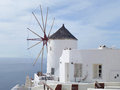 Greek Traditional Style Windmill and White Villa at Oia Village on Santorini Island, Greece Royalty Free Stock Photo