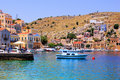 Greek village colorful harbor of the of symi Stock Photography