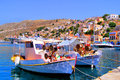 Greek village colorful harbor of the of symi Stock Images