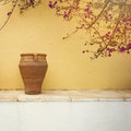 Greek village house detail. Vintage vase over wall background Royalty Free Stock Photo