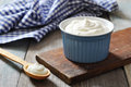 Greek yogurt in a ceramic bowl with spoons on wooden background Royalty Free Stock Photography