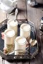 Greek yogurt in glass jars on a metal vintage tray Royalty Free Stock Photo