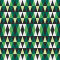 Green abstract geometric seamless pattern of triangles