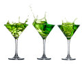 Green alcohol cocktail set with splash on white