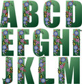 Green Alphabet with flowers Stock Photos