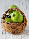 Green apple in the backet basket selective focus Stock Photography