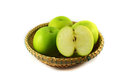 Green apple basket isolated on white in studio Stock Images