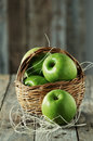 Green apple in the basket selective focus and retro style Stock Photos