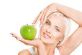 Green apple beautiful young woman holding in hands Royalty Free Stock Photo
