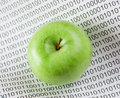 Green apple on binary code Royalty Free Stock Photo