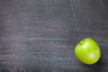 Green apple on blackboard or chalkboard background Royalty Free Stock Photo