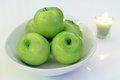 Green apple and candle Royalty Free Stock Photos