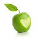 Green apple with cut heart isolated on white Royalty Free Stock Photos