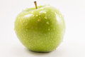 Green apple with drops Royalty Free Stock Photo