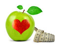 Green apple with heart and measuring tape isolated on white Royalty Free Stock Photo