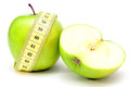 Green apple with measure tape on a white background Stock Photos