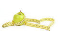 Green apple with a measuring tape and heart symbol isolated on white background Royalty Free Stock Photos