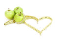 Green apple with a measuring tape and heart symbol isolated on white background Stock Photo