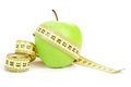 Green apple and measuring tape isolated on white background Royalty Free Stock Photo