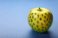 Green apple with numbers on blue background Royalty Free Stock Photo