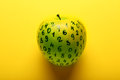 Green apple with numbers on yellow background Royalty Free Stock Photo